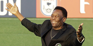 FILE - In this Aug. 3, 2013, file photo, Brazilian soccer legend Pele waves to the crowd during a pregrame cereomy before an NASL soccer game between the New York Cosmos and the Fort Lauderdale Strikers in Hempstead, N.Y. Pele will watching, not playing, when two franchises that helped get soccer rolling in this country renew acquaintances. The Brazilian great's former team, the Cosmos, visit the Strikers on Saturday, rekindling memories of how more than 70,000 fans used to see them play. (AP Photo/Frank Franklin II, File)